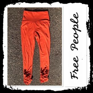 NWT FreePeople Orange CrissCross Workout Leggings